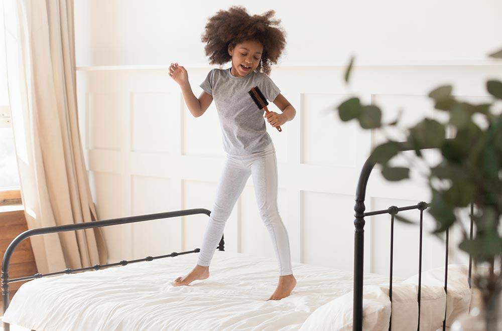 Little girl enjoying while practising singing